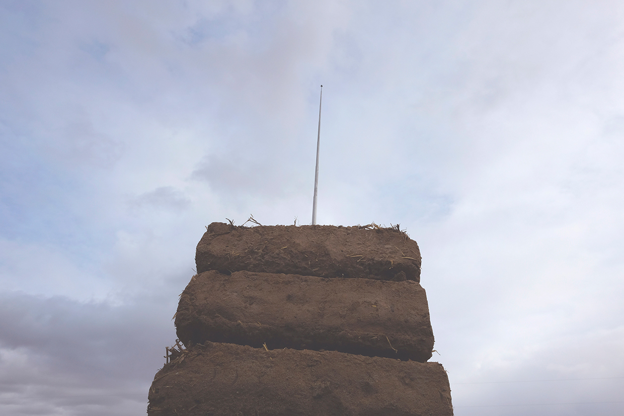Handmade adobe bricks and radio antenna